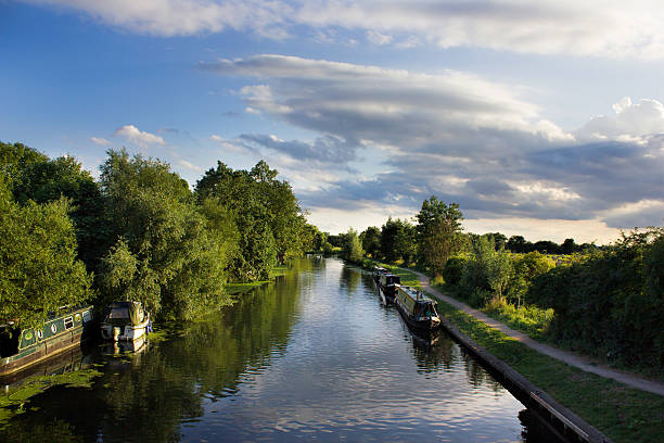 Canal and narrow boats on sunny evening stock photo