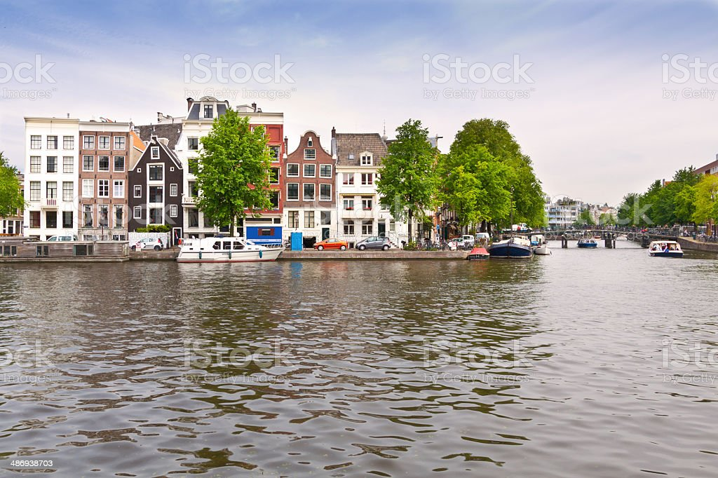 Canal and Row Houses in Historic Part of Amsterdam. royalty-free stock photo