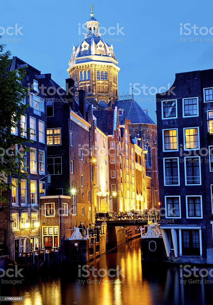Canal and St. Nicolas Church in Amsterdam royalty-free stock photo