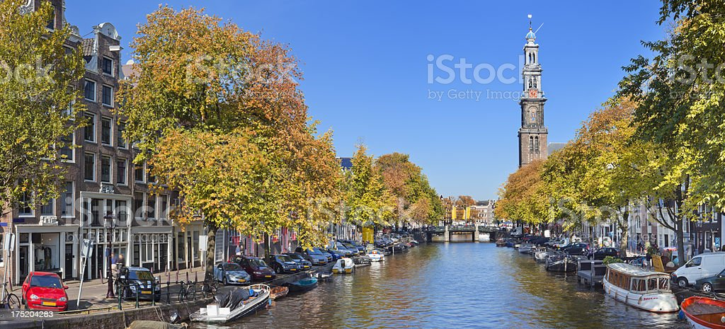 Canal and Westerkerk tower in Amsterdam, The Netherlands in autumn stock photo