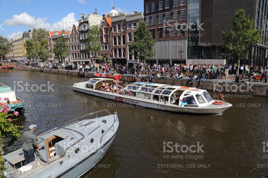 Canal boat and Anne Frank Museum in Amsterdam, Holland stock photo