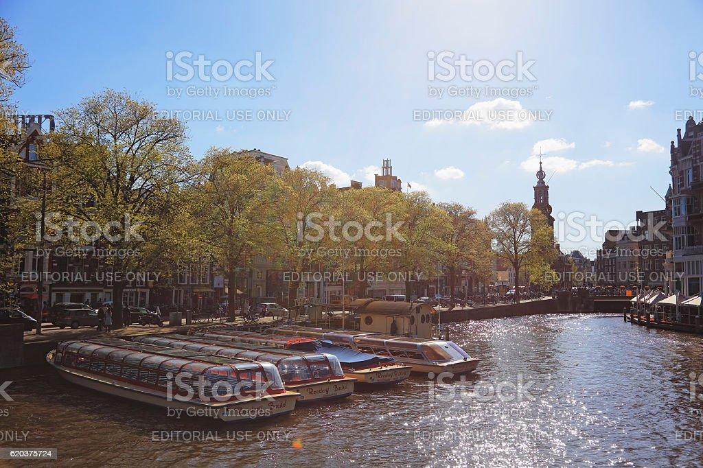 Canal Boat and The Munttoren, Amsterdam, Netherlands zbiór zdjęć royalty-free