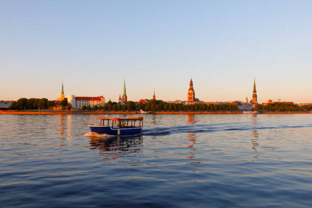 Canal boat on the Düna River in front of Riga's Old Town district, Latvia stock photo