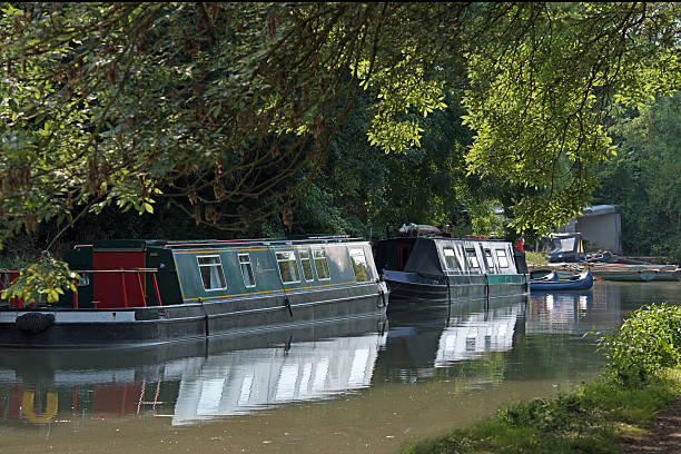 Canal boats moored on the Basingstoke canal stock photo