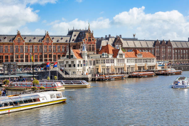 Canal cruise boat in front of Amsterdam central railway station, 2019 stock photo