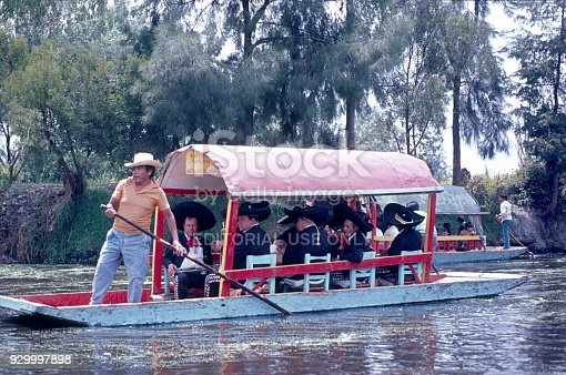 A Mariachi band goes by boat through the canals of Xochimilco.