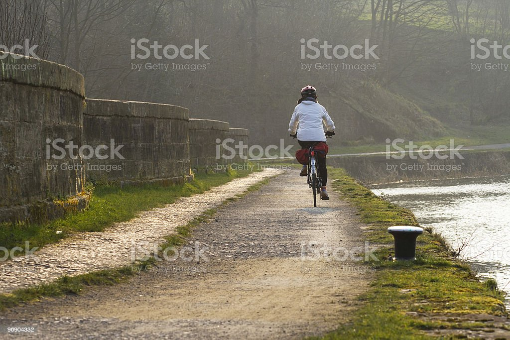 canal cyclist royalty-free stock photo
