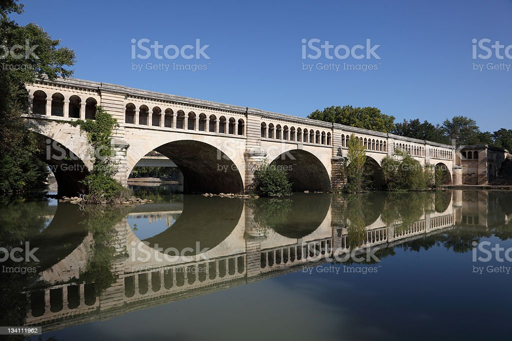 Canal du Midi bridge in Beziers stock photo