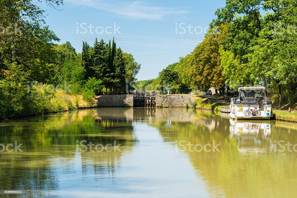 canal du midi with a lock near carcasonne stock photo