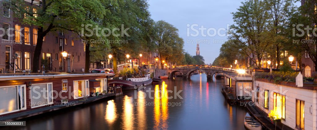 Canal houseboats at dusk, Amsterdam, The Netherlands stock photo