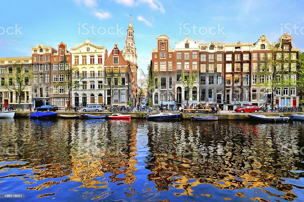 Canal houses of Amsterdam with reflection stock photo