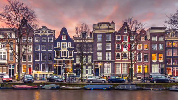 Canal houses on the Brouwersgracht in Amsterdam in vintage toning Colorful canal houses in vintage toning on Brouwersgracht in the grachtengordeal the UNESCO World Heritage site of Amsterdam northern europe stock pictures, royalty-free photos & images