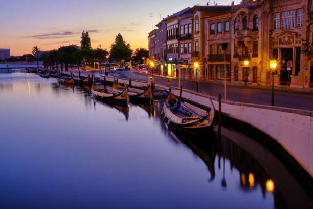 canal in aveiro with tourist boats - aveiro imagens e fotografias de stock