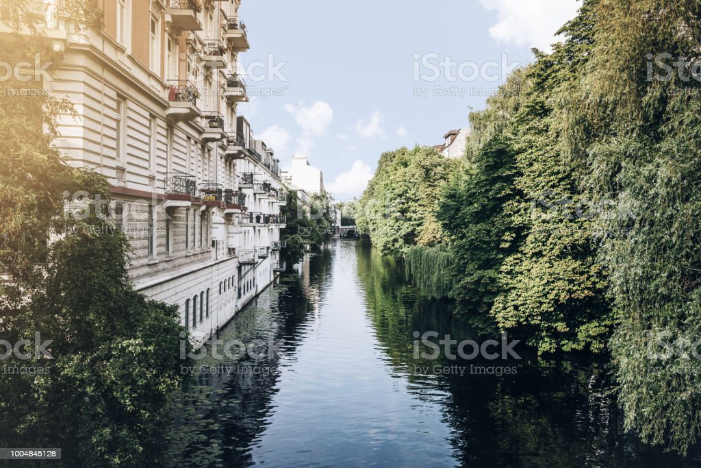 canal in residential neighborhood in Hamburg, Germany on sunny summer day royalty-free stock photo
