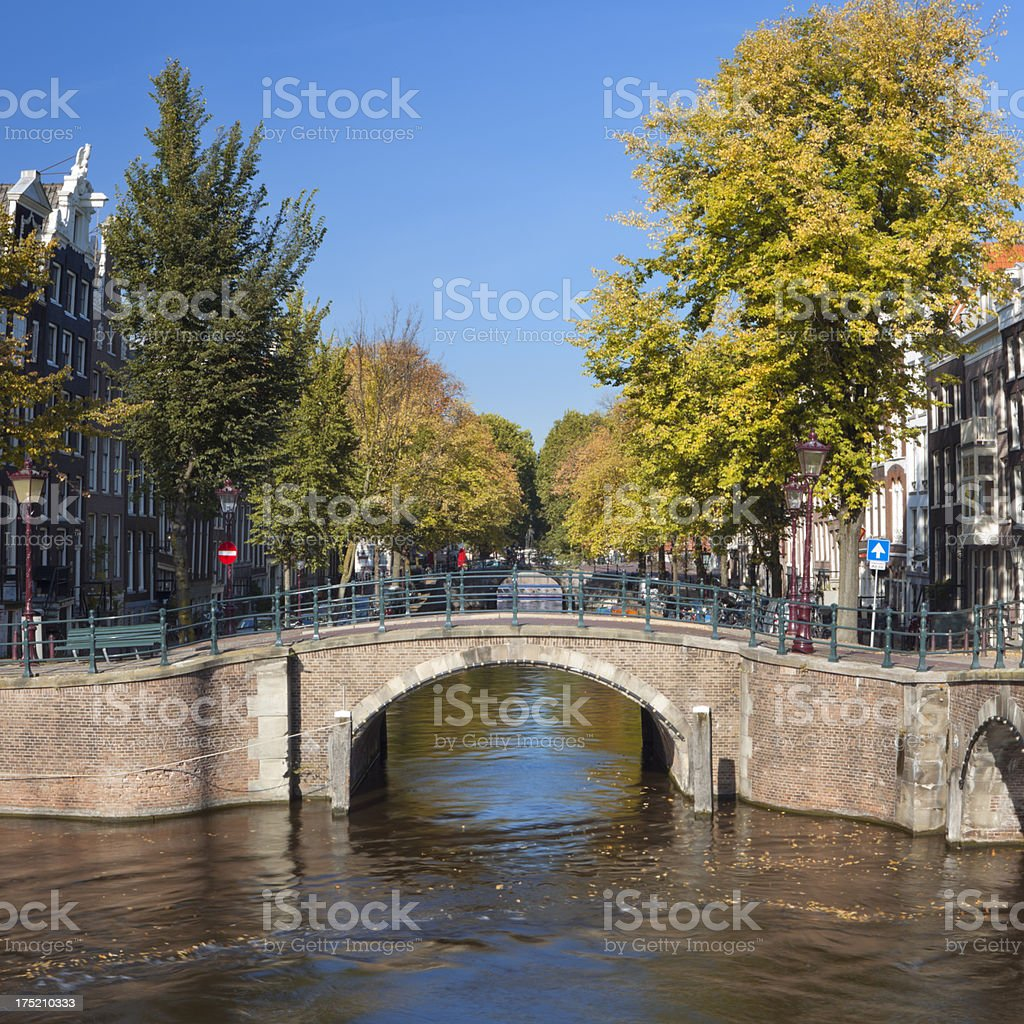 Canal in the city of Amsterdam, The Netherlands in autumn royalty-free stock photo