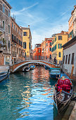 Venice, Italy – August 13, 2017: Gondola Sailing in the Venetian Canals with tourist