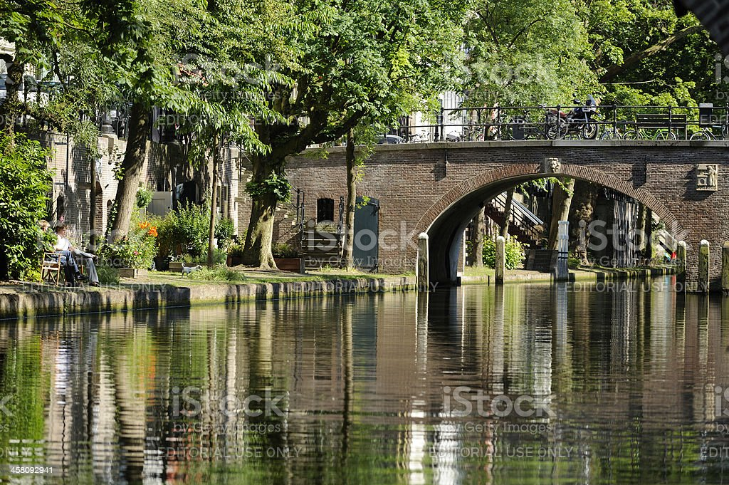 Canal Oudegracht in Utrecht with stone arch bridge Smeebrug stock photo