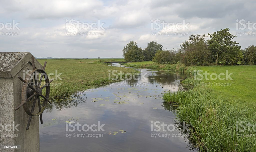 Canal through a rural landscape royalty-free stock photo