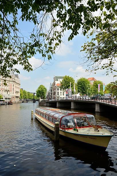 Canal tour Amsterdam stock photo