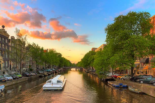 canal tour sunset - keizersgracht stockfoto's en -beelden