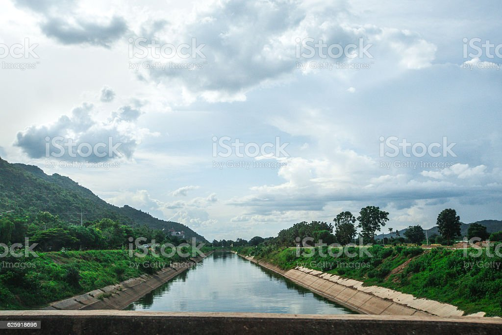 Canal watercourse waterway of water supply with water in country stock photo