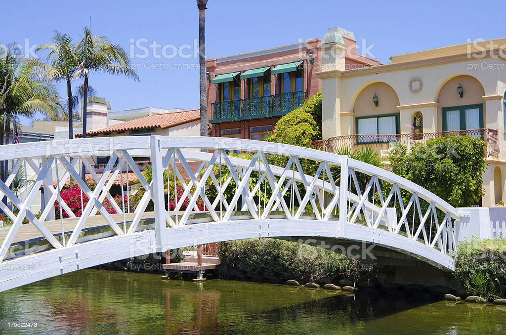 Canal with bridge and houses in Venice, CA stock photo