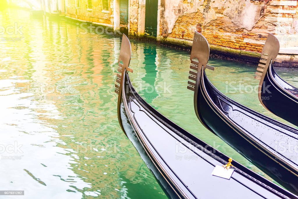 Canal with gondolas in Venice, Italy during sunrise. Tourism concept in Europe stock photo