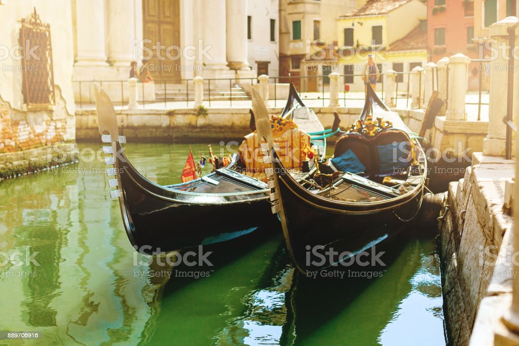 Canal with two gondolas in Venice, Italy. Architecture and landmarks of Venice. Venice postcard with Venice gondolas. stock photo