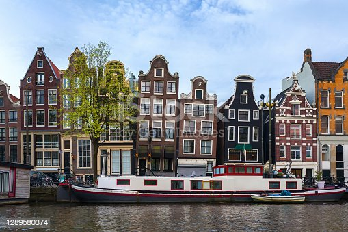 istock Canals and buildings of Amsterdam, Netherlands 1289580374