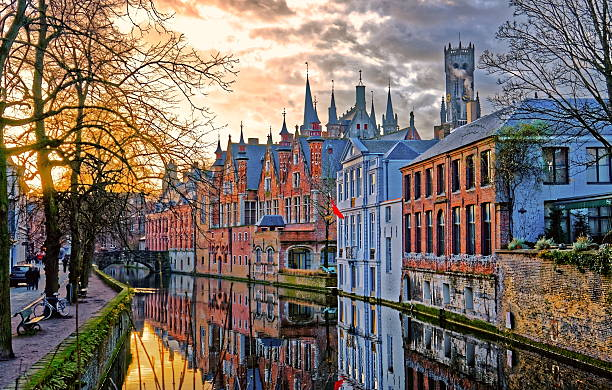 Canals of Bruges, Belgium Canals of Bruges (Brugge), Belgium. Winter evening view. belgium stock pictures, royalty-free photos & images