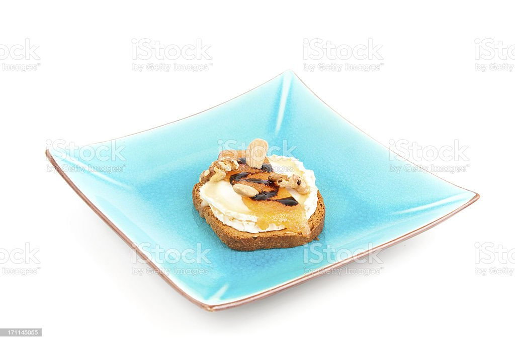 Canape  on a blue plate. royalty-free stock photo