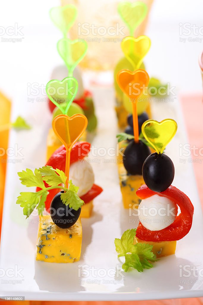 Canape platter with cheese, roasted peppers, olives and grapes. royalty-free stock photo