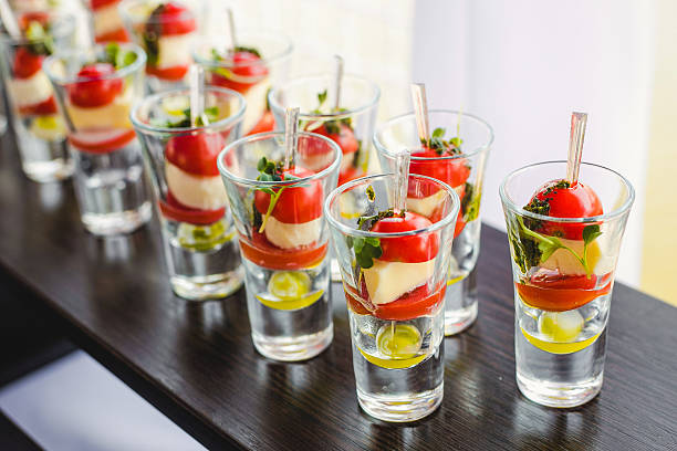 canape with cherry tomatoes, cheese, olives on skewers – Foto