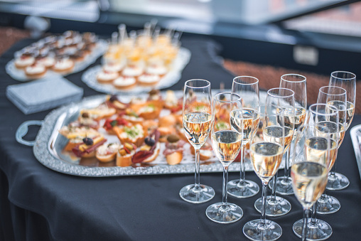 Shot of canapes and champagne for reception.