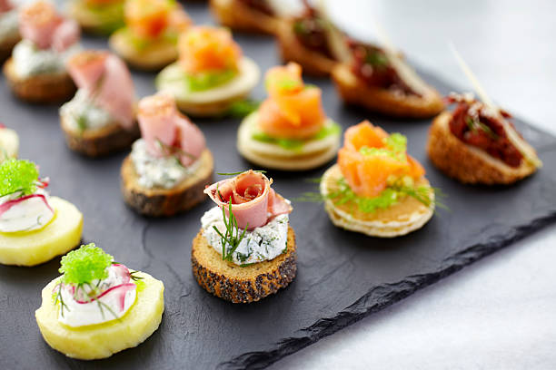 canapes for party - delis stock photos and pictures