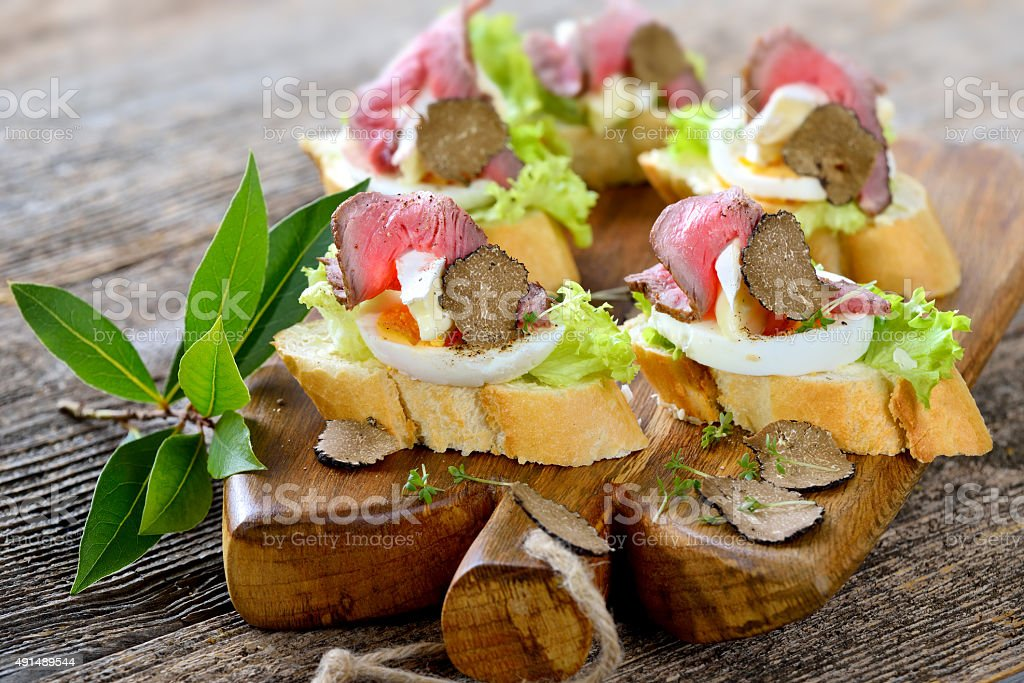 Canapes with roast beef and truffle stock photo