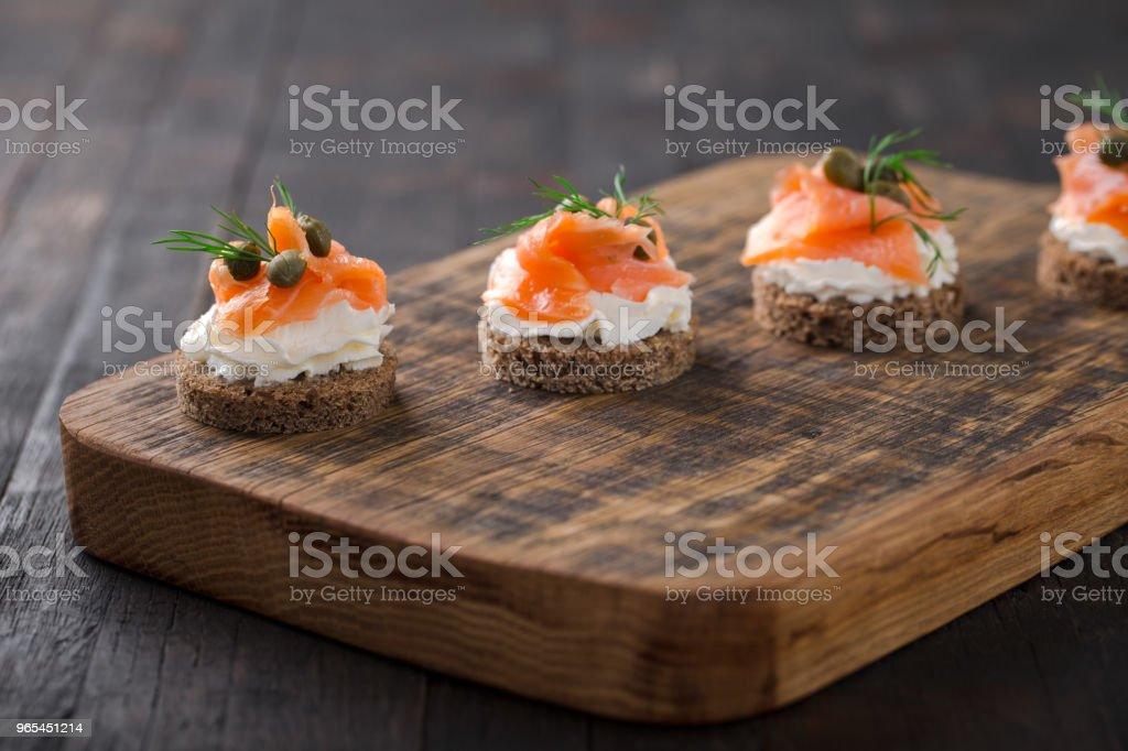 Canapes with smoked salmon. zbiór zdjęć royalty-free