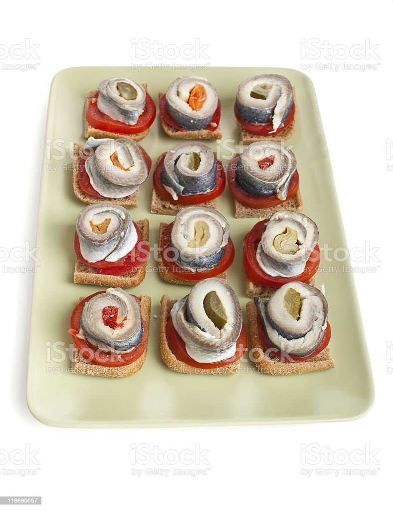 canapes with tomatoes and norwegian herring royalty-free stock photo