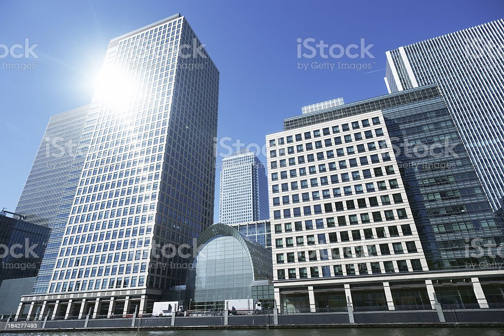 Canary Wharf business buildings in London with sun reflection royalty-free stock photo