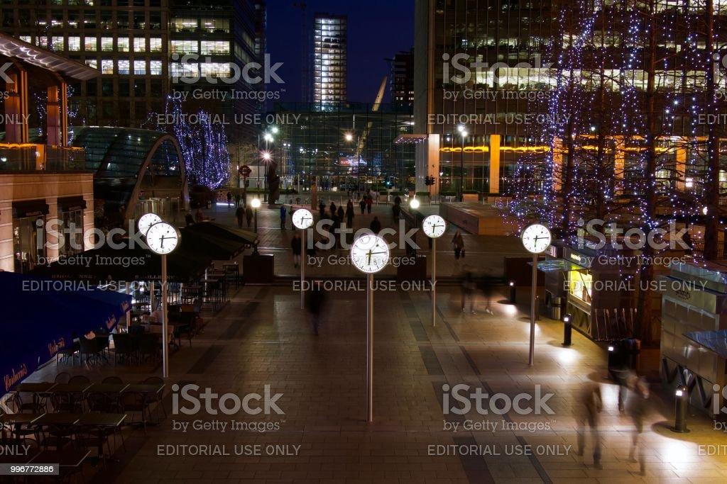 Canary Wharf clocks at night stock photo