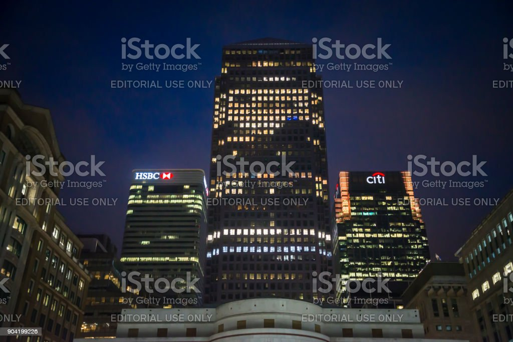 Canary Wharf financial district including One Canada Square, HSBC and Citibank skyscrapers at night in Docklands, London, England, UK stock photo