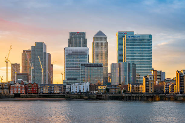 Canary Wharf in London at sunset stock photo