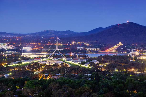 canberra, australia, at dusk - canberra skyline bildbanksfoton och bilder