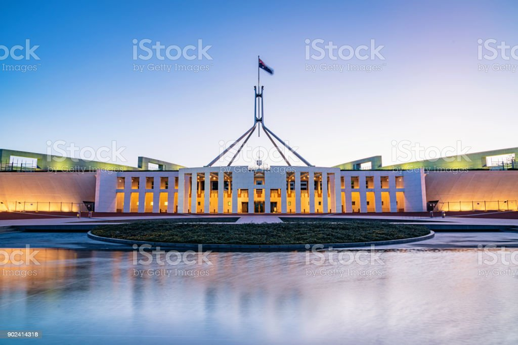 Canberra Australian Parliament House illuminated at Twilight stock photo