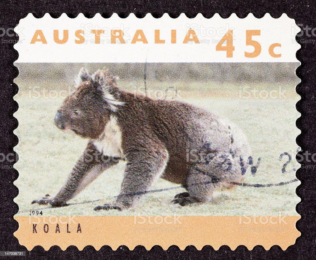 Canceled Australian Postage Stamp Koala Bear Sitting on Grassy Ground royalty-free stock photo