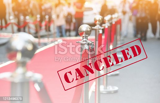 canceled event. red carpet and barrier on entrance before opening ceremony