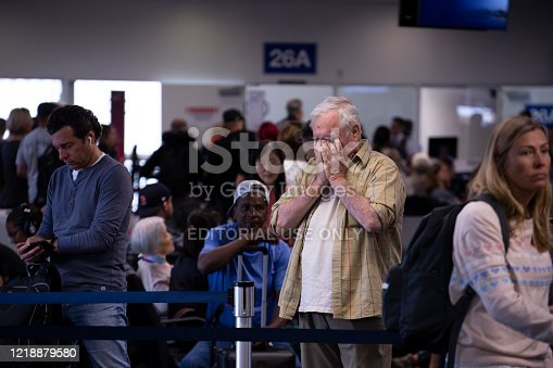 Los Angeles, California / USA - June 4, 2019: A passenger finds out their flight has been canceled Los Angeles International Airport.