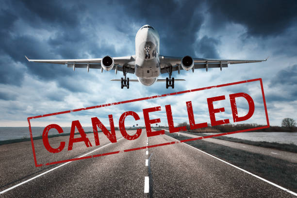Canceled flights in Europe and USA airports. Travel vacations cancelled because of pandemic of coronavirus. Flying passenger airplane and runway. Flight cancellation. Aircraft with text. Covid-19 stock photo