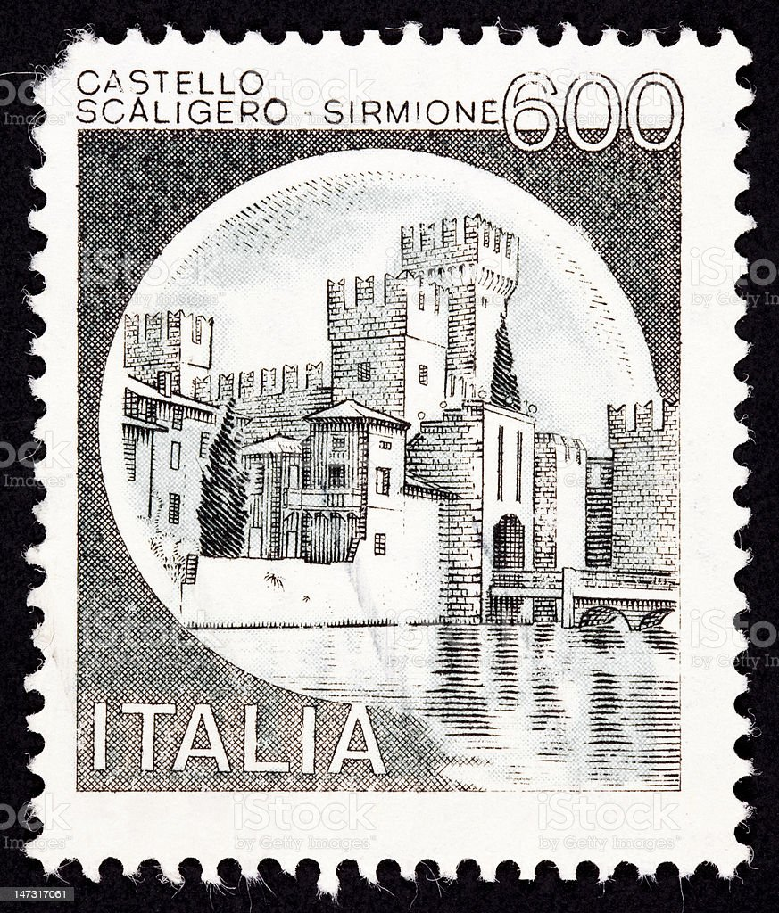 Canceled Italian Postage Stamp Scaliger Castle, Castello Scaligero, Sirmione, Italy royalty-free stock photo