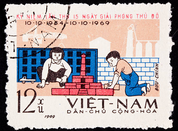 Canceled North Vietnamese Postage Stamp Children Playing Building City Blocks Stock Photo